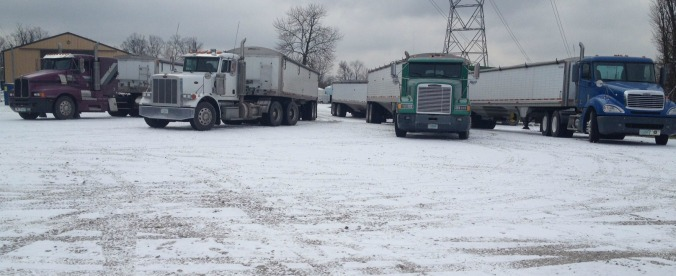 Semis that belong to our fellow farmer friends that came to help us back in December.