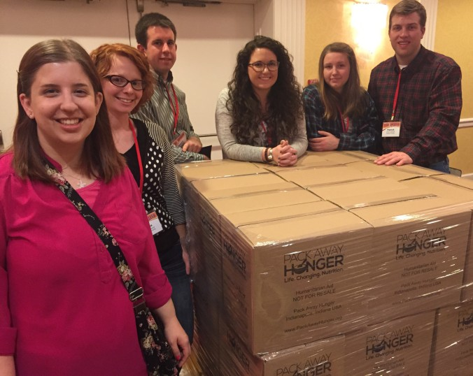 Morgan County Young Farmer members with packed boxes of meals for Pack Away Hunger.